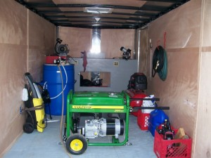 Mobile lawn mower repair service trailer.